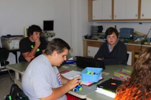 Photo of students working in class